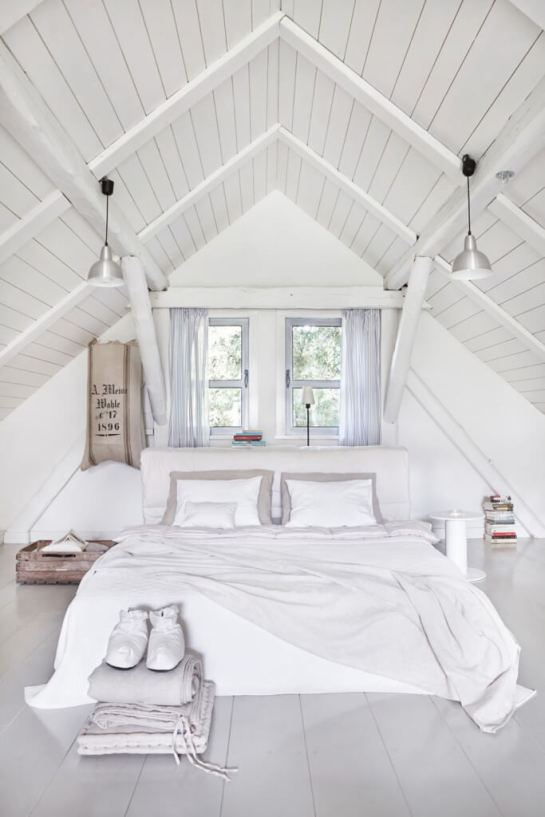 all-white-bedroom-beneath-the-vaulted-ceiling